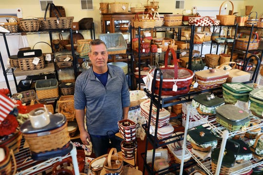 Geoff Snyder, the Basket Guy, stands admidst his wares in his store on Main Street in Dresden. Once one of Longaberger's top sellers, he still sells baskets online and in his store.