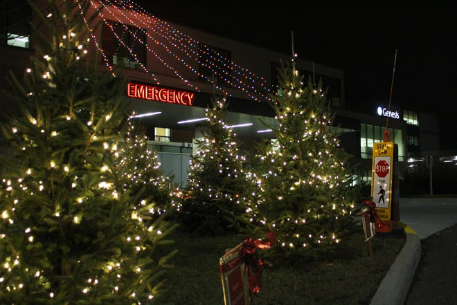 Hundreds gathered at Genesis HealthCare System on Nov. 16 for the lighting ceremony of the Tree of Love. Dozens of trees lining the hospital's exterior are decorated and dedicated to loved ones. In its 32nd year, the annual event raises money for the hospital and this year the donations will be used to purchase wheelchairs.