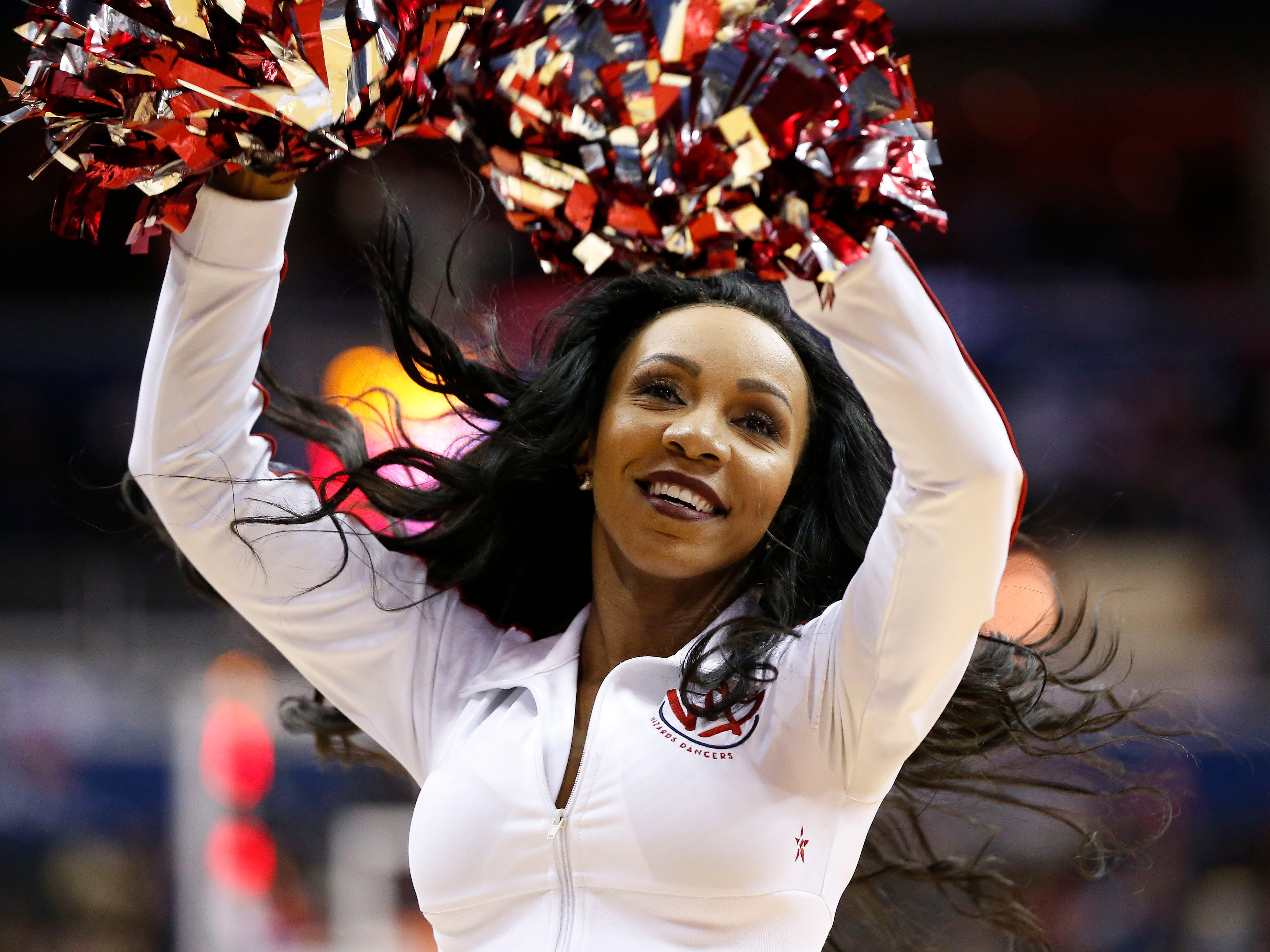 Nov. 18: The Wizards dance team performs during a stop in play against the Trail Blazers in Washington.
