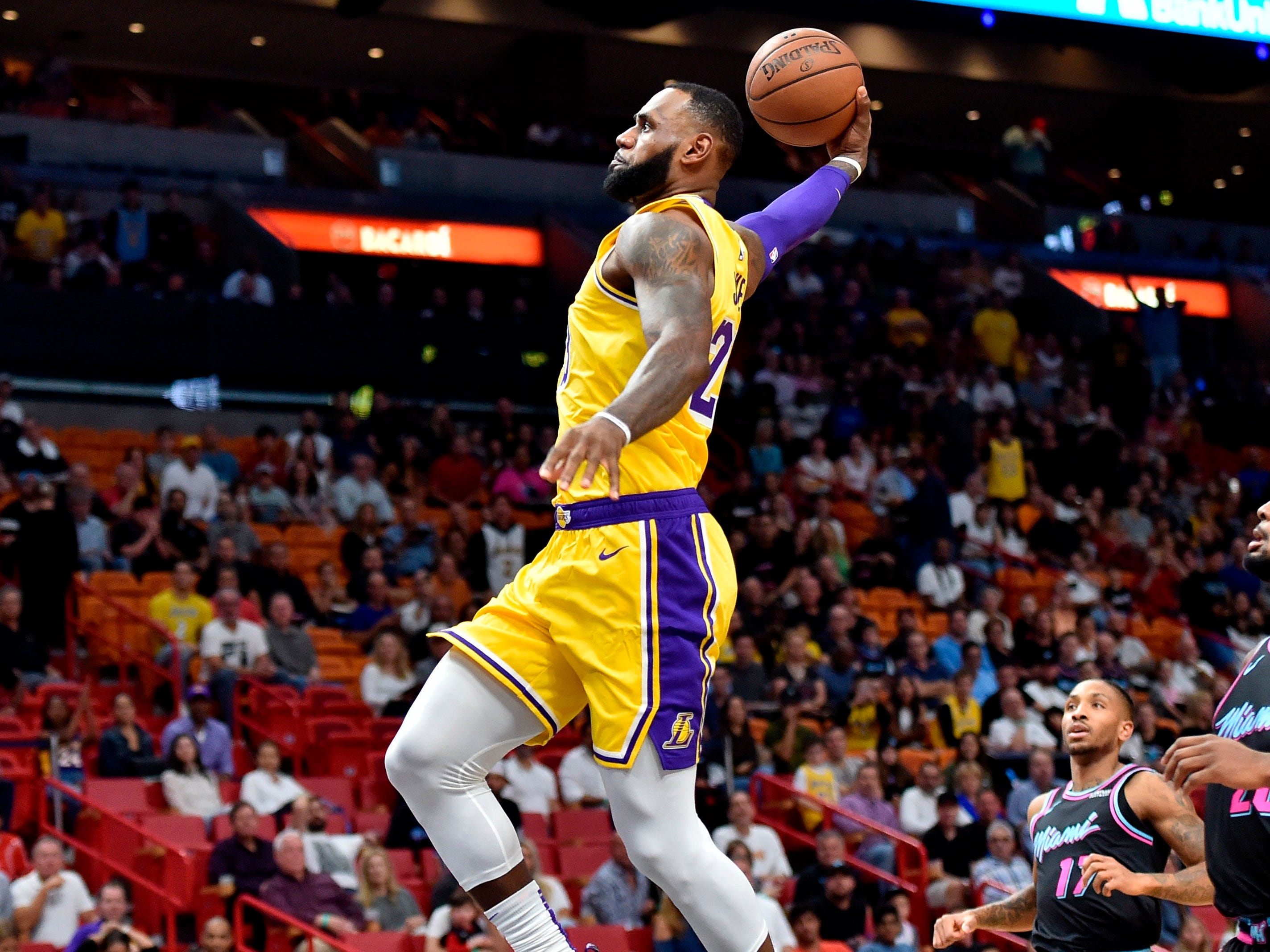 Nov. 18: Lakers forward LeBron James soars to the bucket for the one-handed finish during the first half against the Heat.