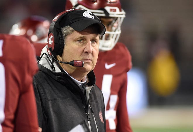 Mike Leach looks on during Saturday's game against Arizona.