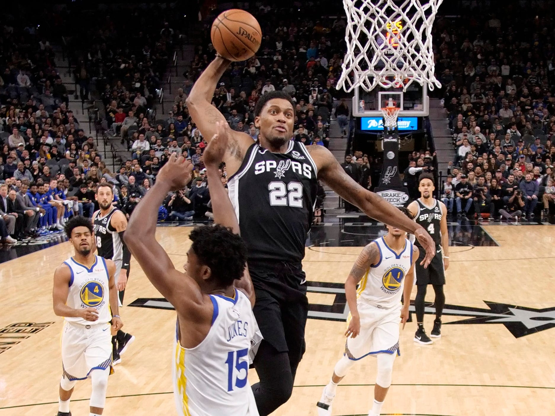 Nov. 18: Spurs forward Rudy Gay (22) rises up for the ferocious one-handed flush over Warriors center Damian Jones (15) during the first half in San Antonio.