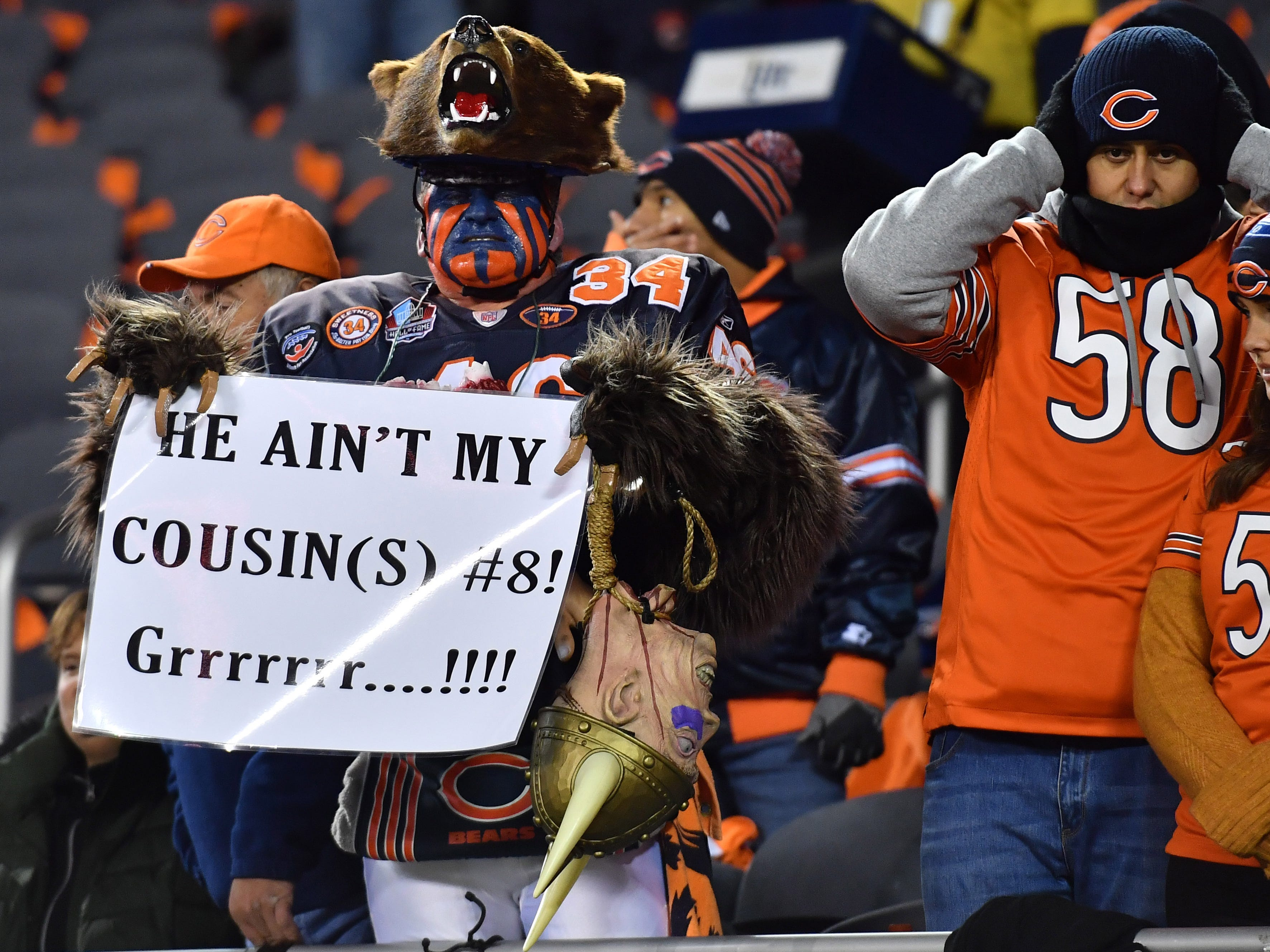 The Chicago Bears fan known as Bearman, Don Wachter, holds a sign during warmups before the game between the Chicago Bears and the Minnesota Vikings at Soldier Field.