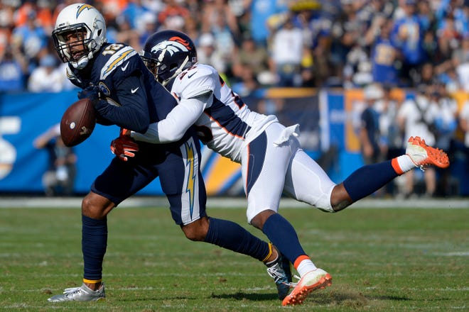 Los Angeles Chargers wide receiver Keenan Allen (13) misses a catch as Denver Broncos strong safety Darian Stewart (26) defends during the first quarter at StubHub Center.