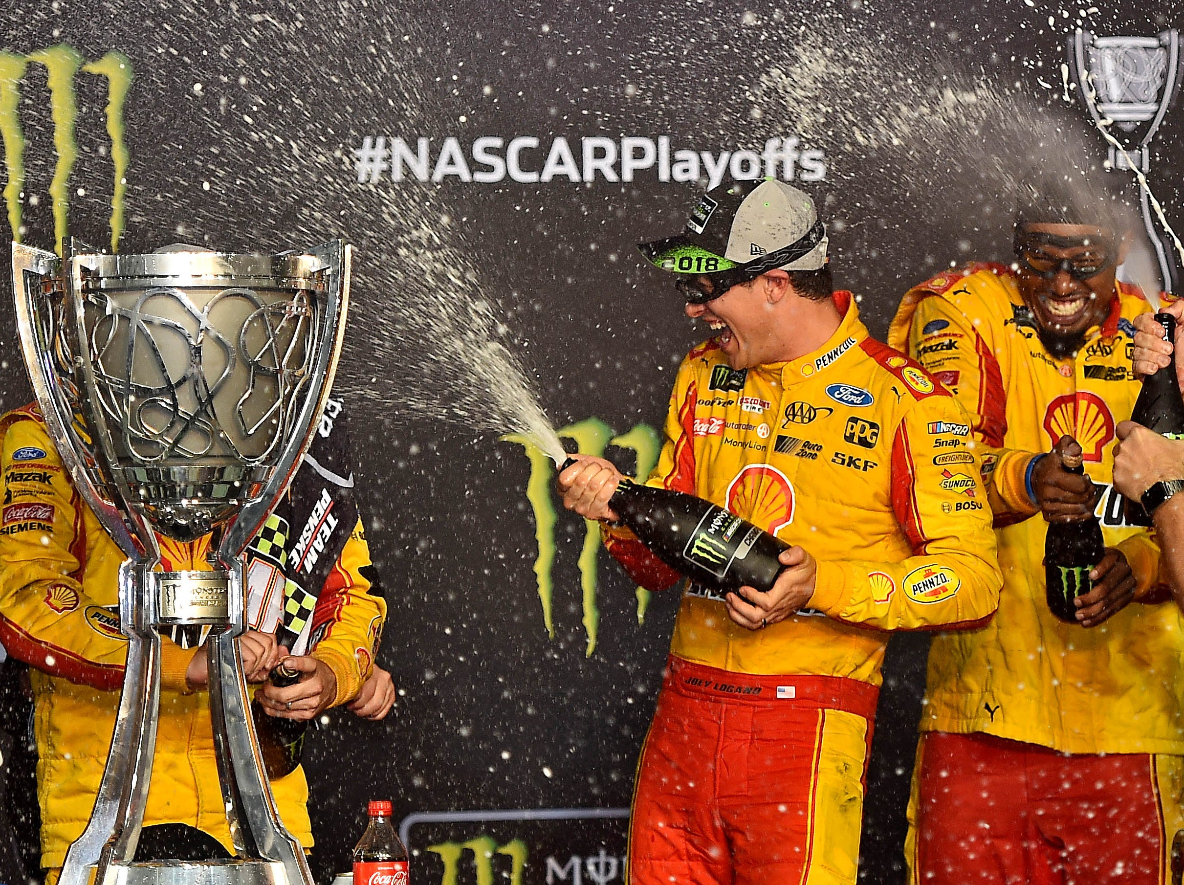 Joey Logano celebrates winning the NASCAR Cup Series championship at Homestead-Miami Speedway.