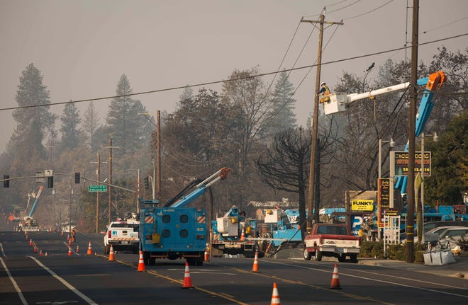 PG&E crews work in the devastated town of Paradise, Calif. to restore the power to the area on Nov. 18, 2018.