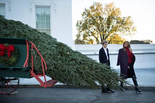First lady Melania Trump and Barron Trump greet the official White House Christmas Tree on Nov. 20, 2017, for the Trumps' first Christmas in the White House.