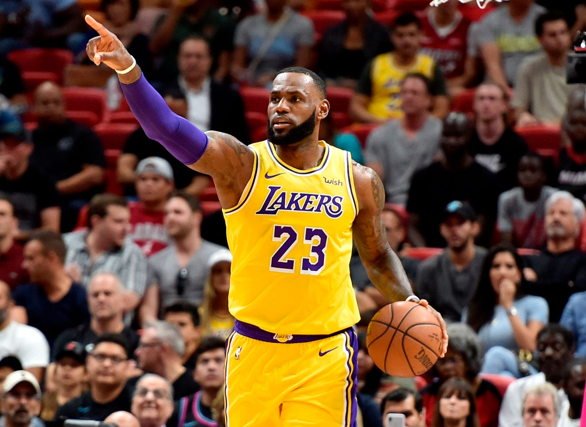 Nov. 18: LeBron James directs the offense during the first half against the Heat in Miami. James returned to one of his former homes and dropped a season-high 51 points.
