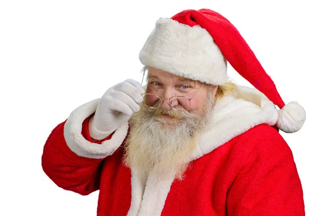 Santa Claus removing his glasses Portrait of cheerful Santa Claus isolated on white background close up Santa Clause tuching his eye glasses