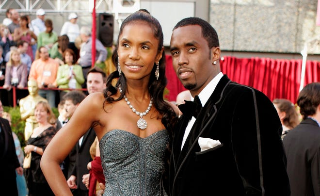 """Sean """"Diddy"""" Combs with Kim Porter at the 77th Academy Awards in Los Angeles in February 2005."""