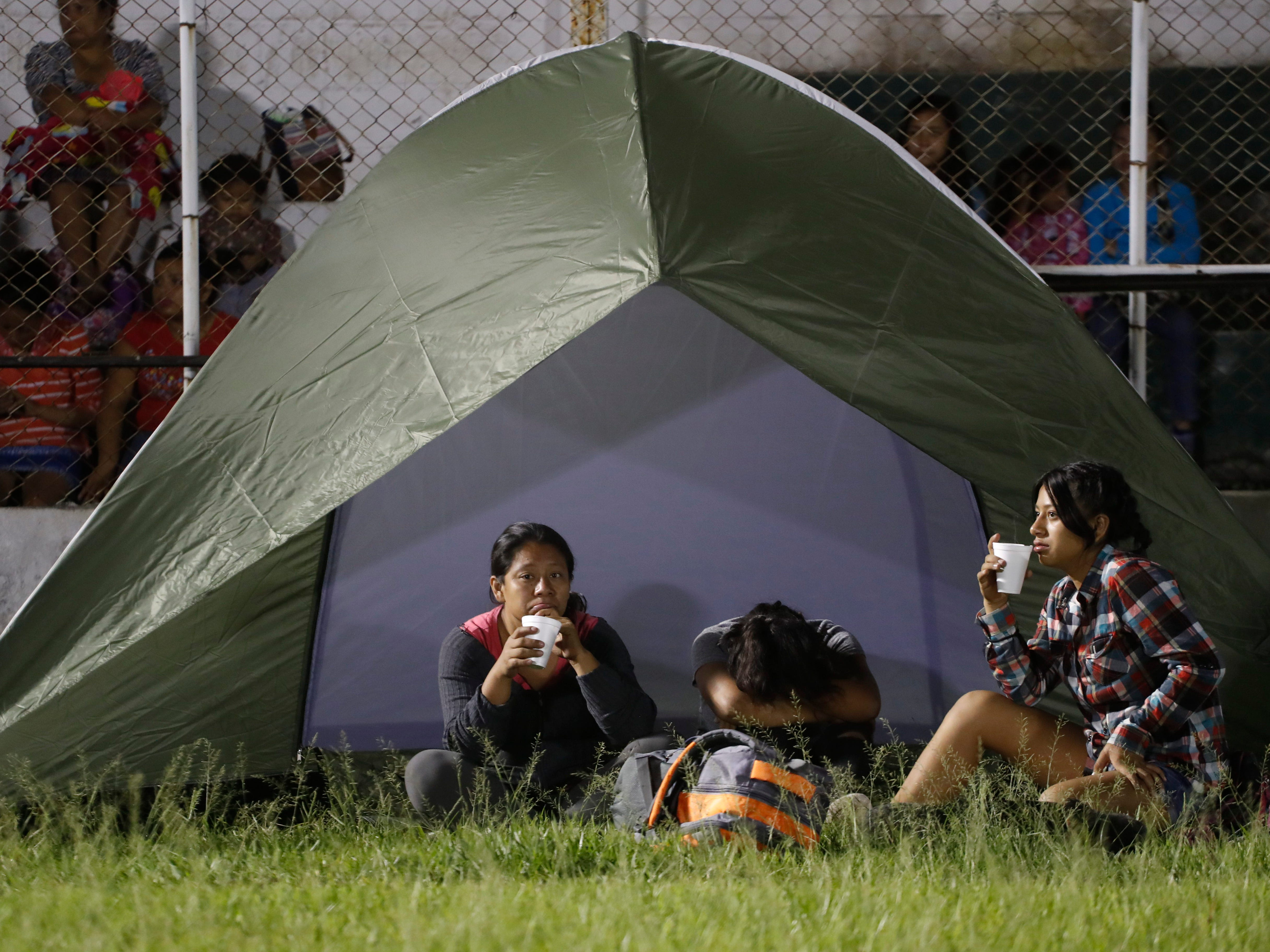 Evacuees from the Volcano of Fire area rest at an emergency shelter in Escuintla, Guatemala, Monday, Nov. 19, 2018.