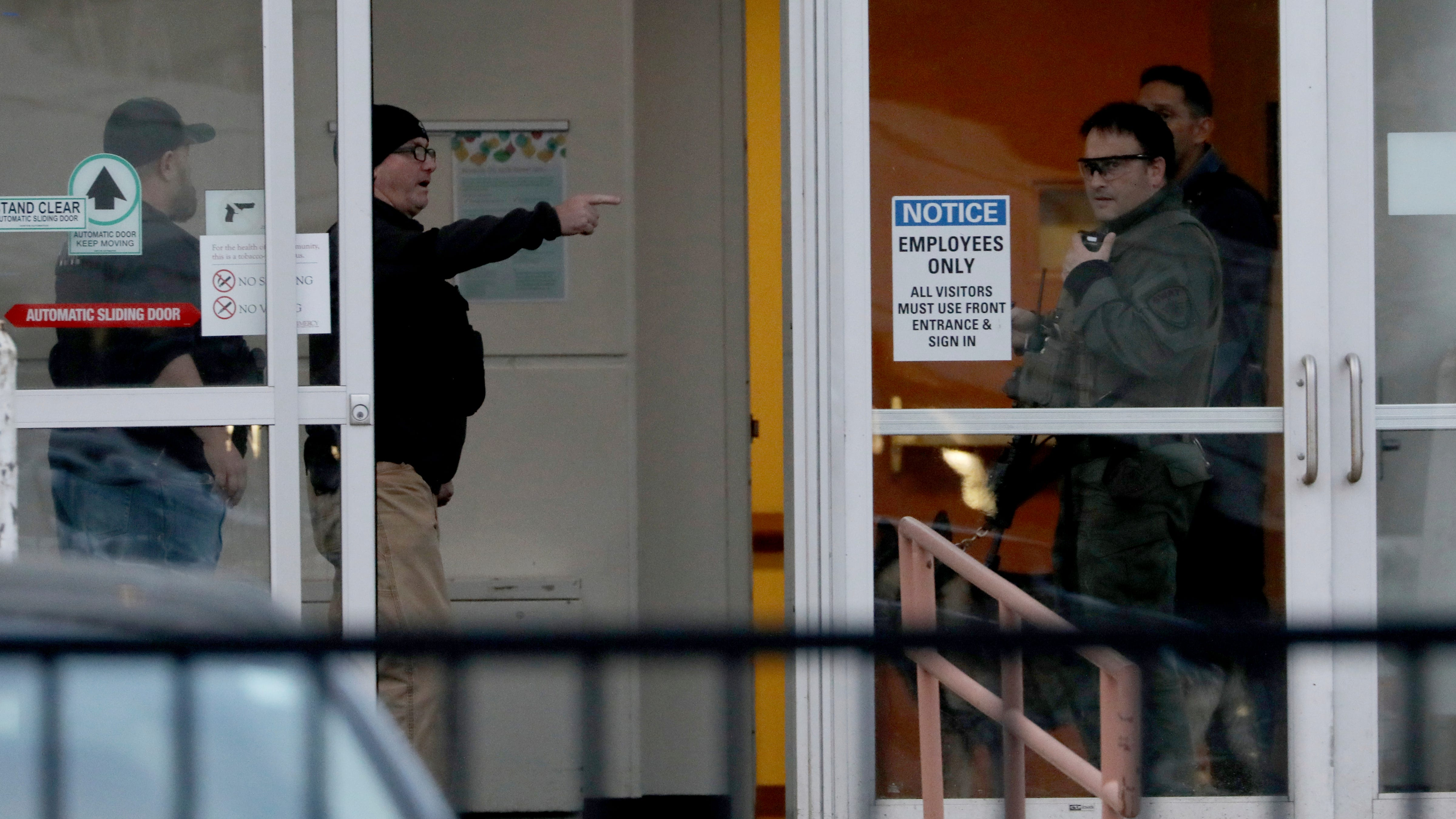 Law enforcement officers including Chicago SWAT work an entrance at Mercy Hospital on Nov. 19, 2018, in Chicago.