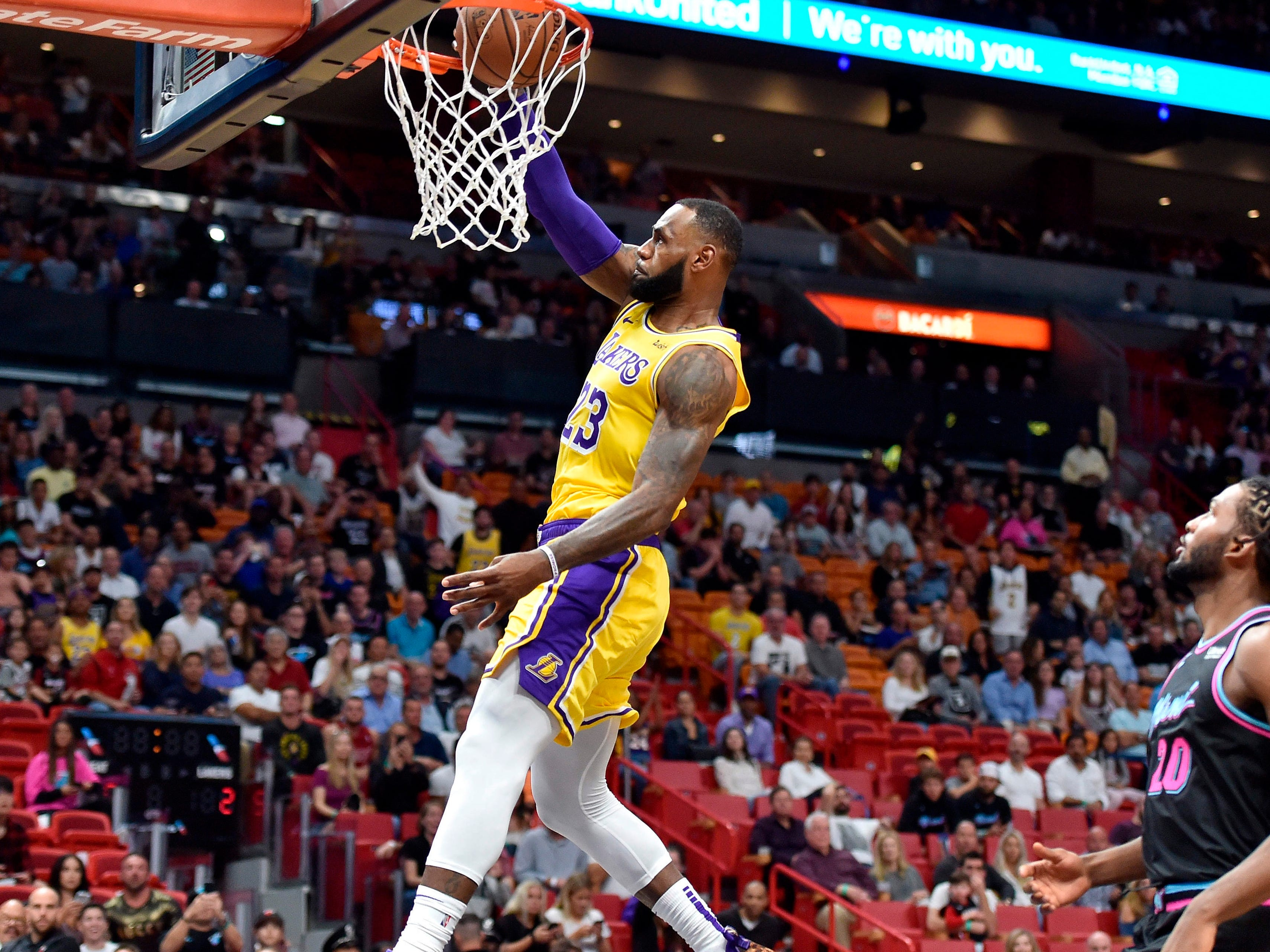 Nov. 18: Lakers forward LeBron James slams home two of his season-high 51 points against the Heat in Miami.