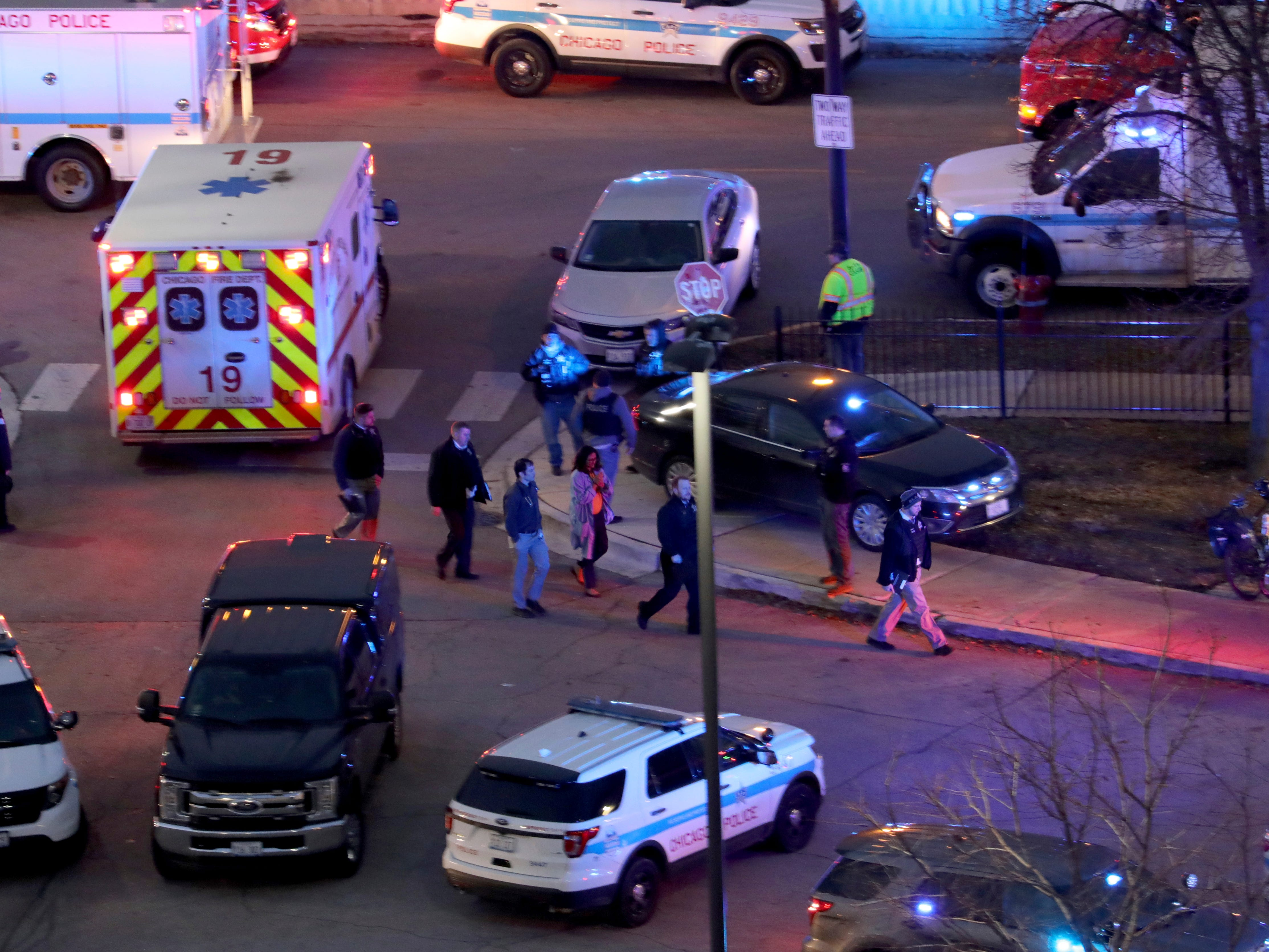Law enforcement officials work near Mercy Hospital in Chicago on Nov. 19, 2018. A shooting at the Chicago hospital has wounded multiple people, including a suspect and a police officer, authorities said.