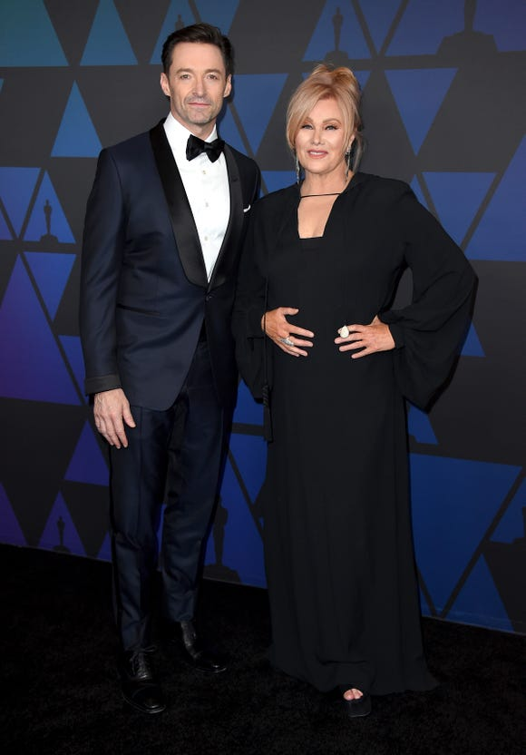Hugh Jackman, left, and Deborra-lee Furness arrive at the Governors Awards on Sunday, Nov. 18, 2018, at the Dolby Theatre in Los Angeles. (Photo by Jordan Strauss/Invision/AP) ORG XMIT: CAPM195