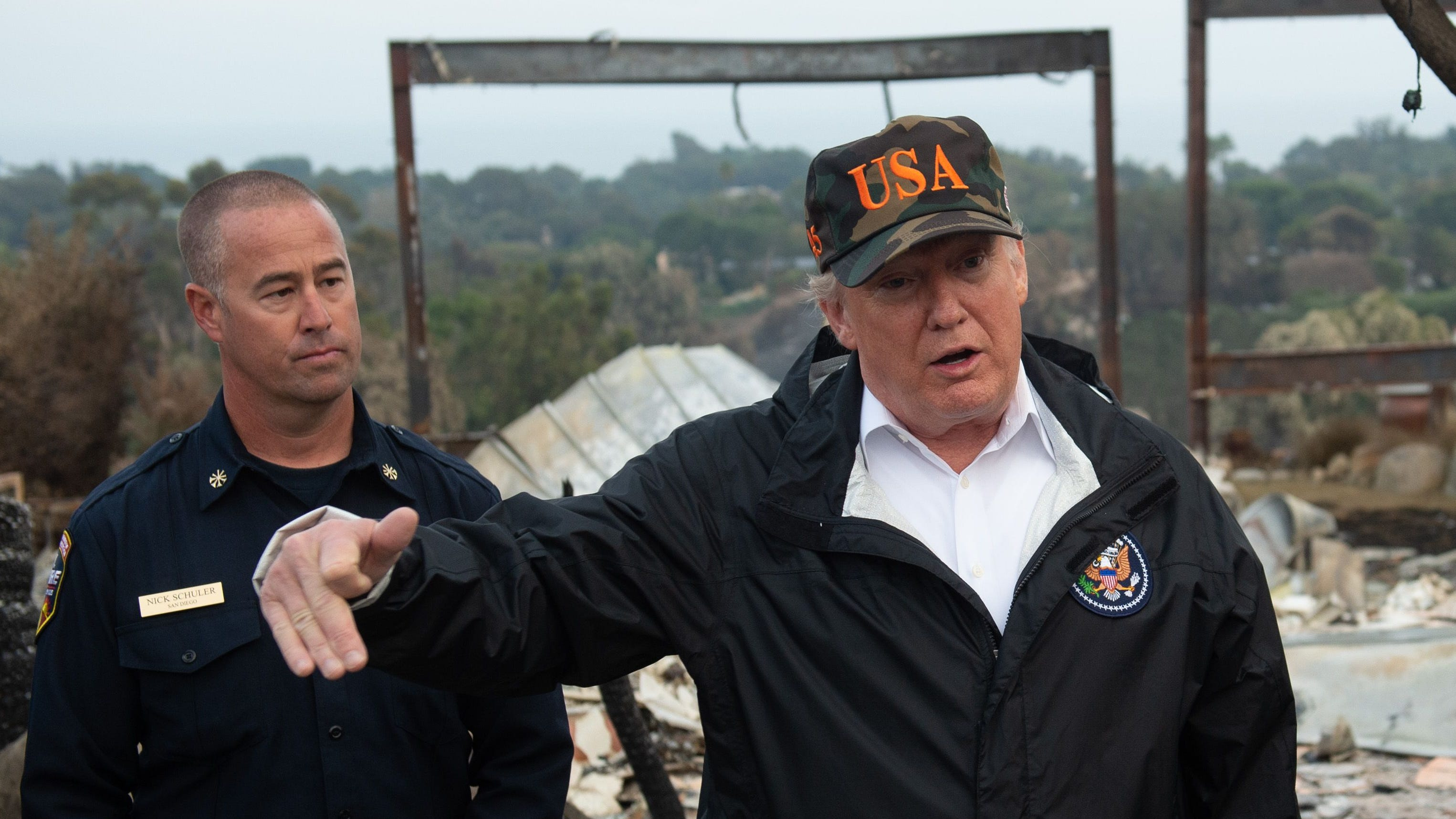 President Donald Trump views damage from the wildfires in Malibu, California, on Nov. 17, 2018.