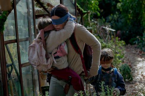 "Sandra Bullock is a blindfolded mother on the run in ""Bird Box."""