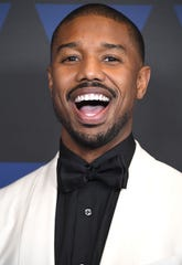 Michael B. Jordan walks on the carpet at Governor's Awards in Los Angeles on Sunday.