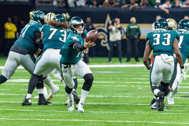 Philadelphia Eagles quarterback Carson Wentz (11) bobbles the snap against the New Orleans Saints at the Mercedes-Benz Superdome.