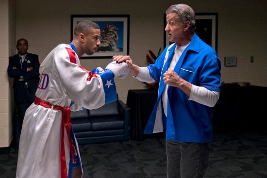 Rocky (Sylvester Stallone, right) reluctantly trains Adonis (Michael B. Jordan) for his confrontation in the ring with Viktor Drago.