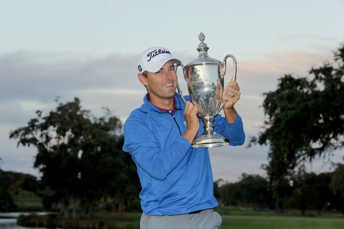 Nov. 18: Charles Howell III poses with the trophy after winning the RSM Classic at the Sea Island Golf Club Seaside Course.