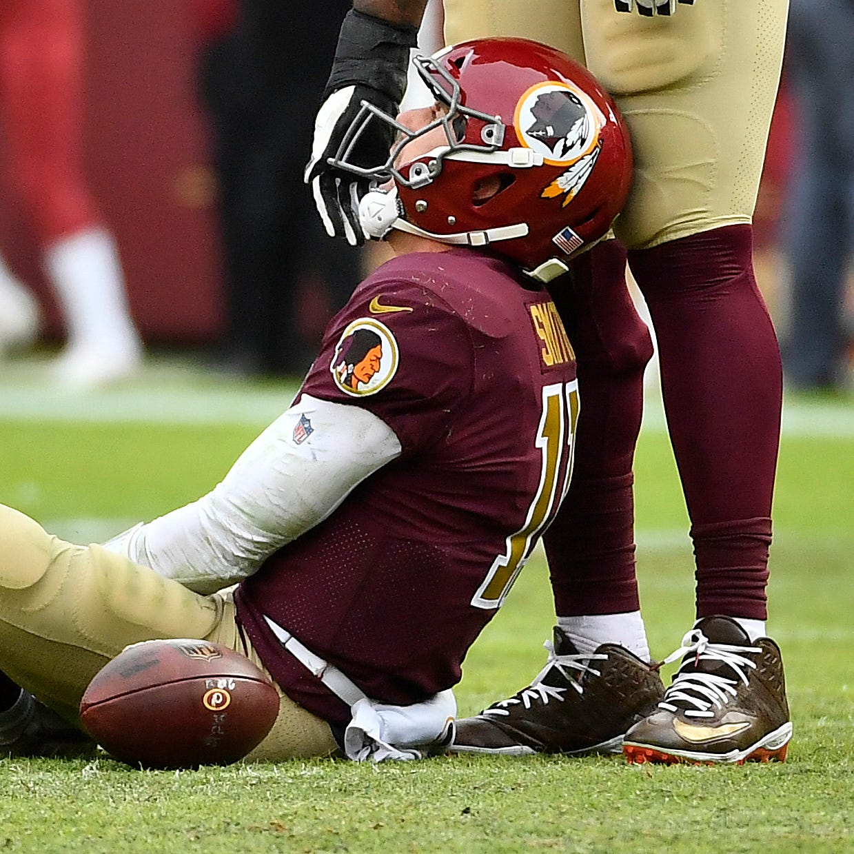 Washington Redskins quarterback Alex Smith (11) reacts after suffering a broken leg in the second half against the Houston Texans during the second half at FedEx Field.