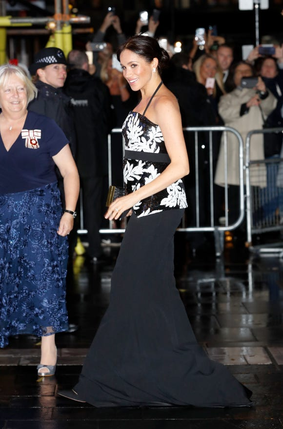 Duchess Meghan's evening maternity look was comprised of a Safiyaa printed top and black satin mermaid skirt.