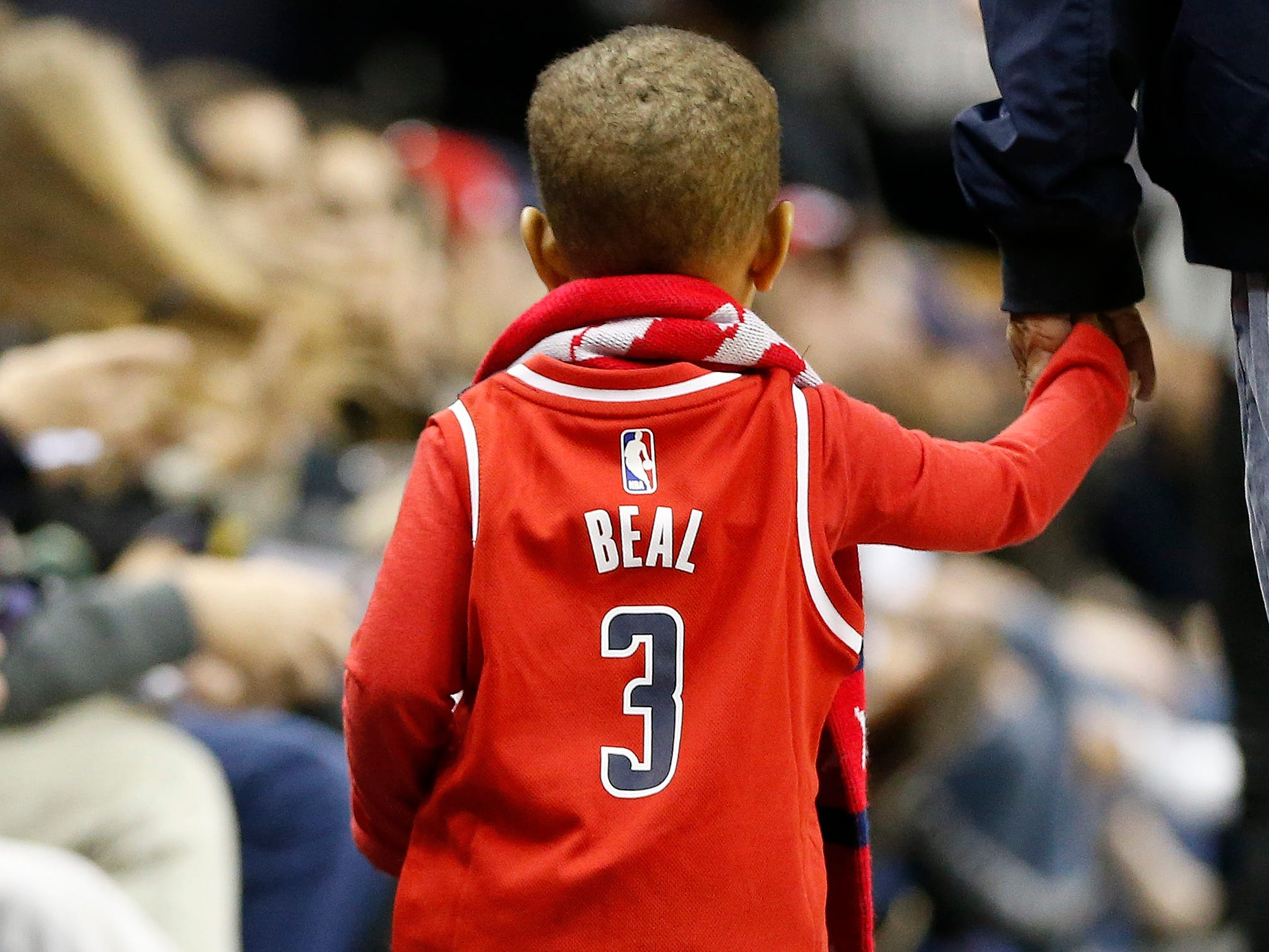 Nov. 18: A young fan sports his Bradley Beal jersey at the Wizards-Blazers game in Washington.