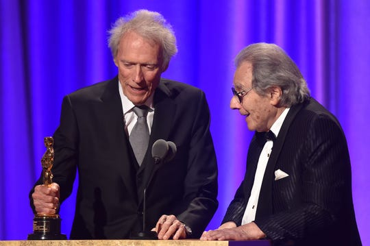 Clint Eastwood introduces Argentinian composer Lalo Schifrin, right, at the Governors Awards.