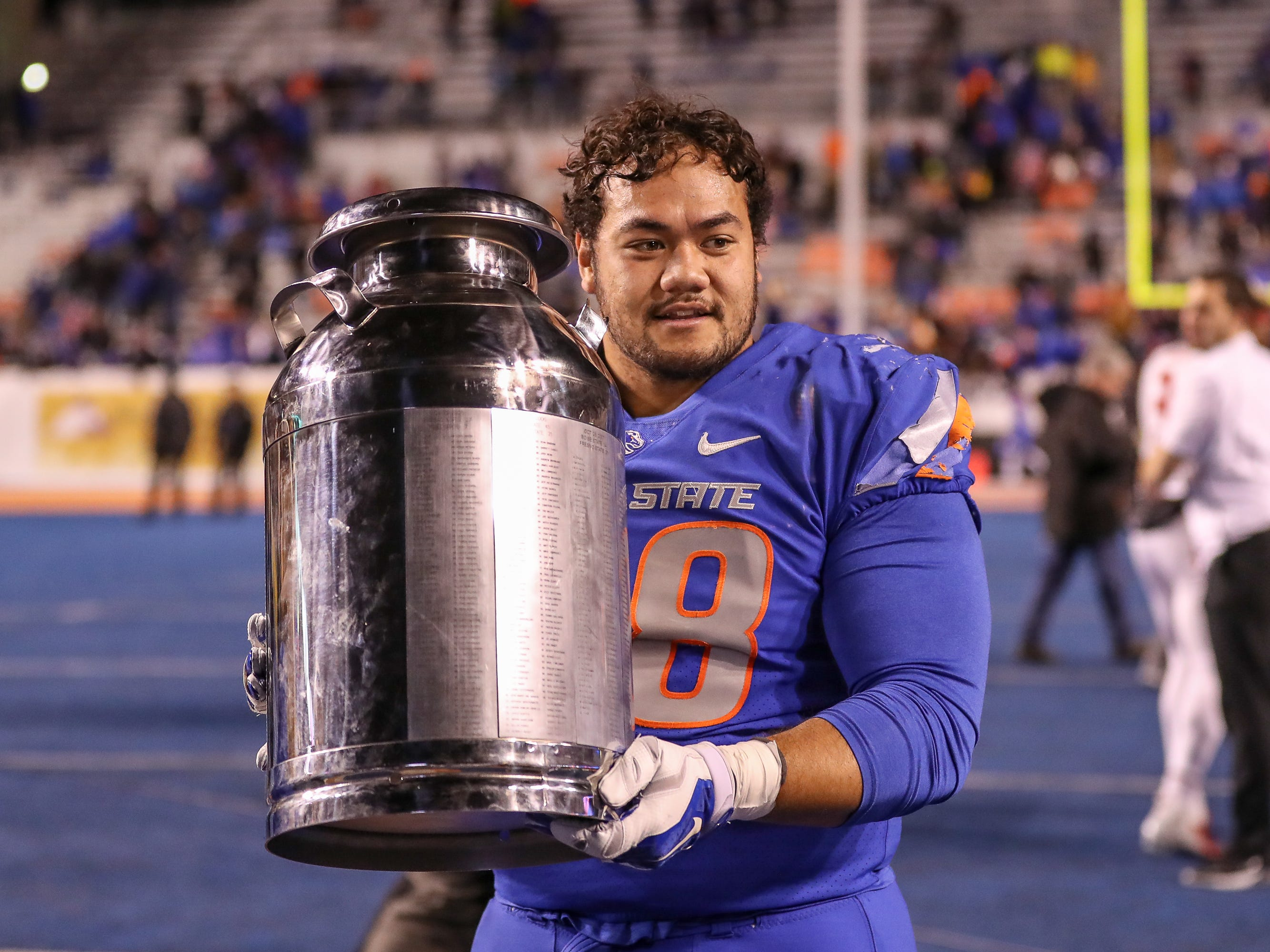 Milk Can: Boise State nose tackle Sonatane Lui celebrates by holding the Milk Can after the Broncos beat Fresno State, 24-17, at Albertsons Stadium on Nov. 9.