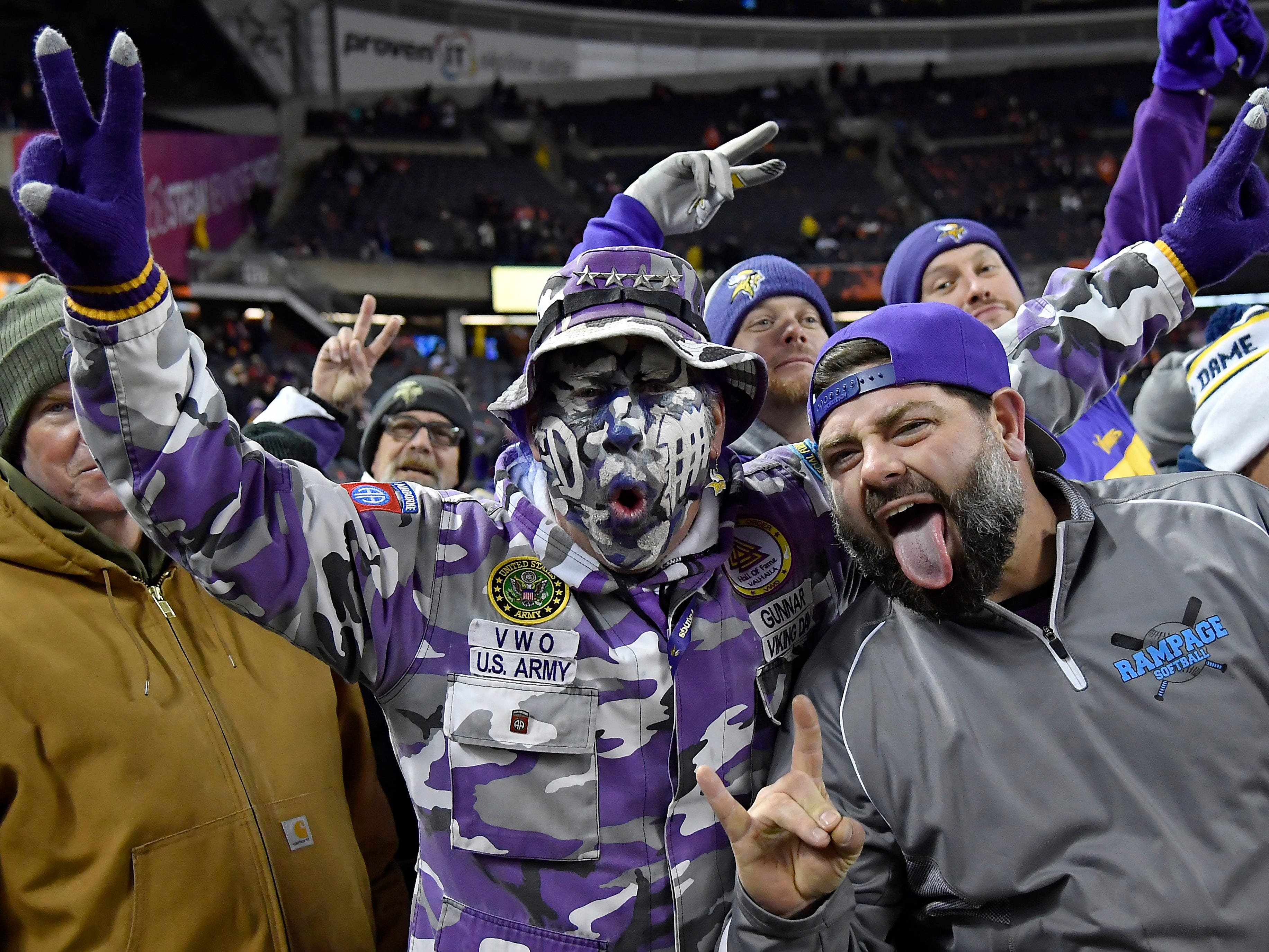 Minnesota Vikings fans cheer before the game between the Chicago Bears and the Minnesota Vikings at Soldier Field.