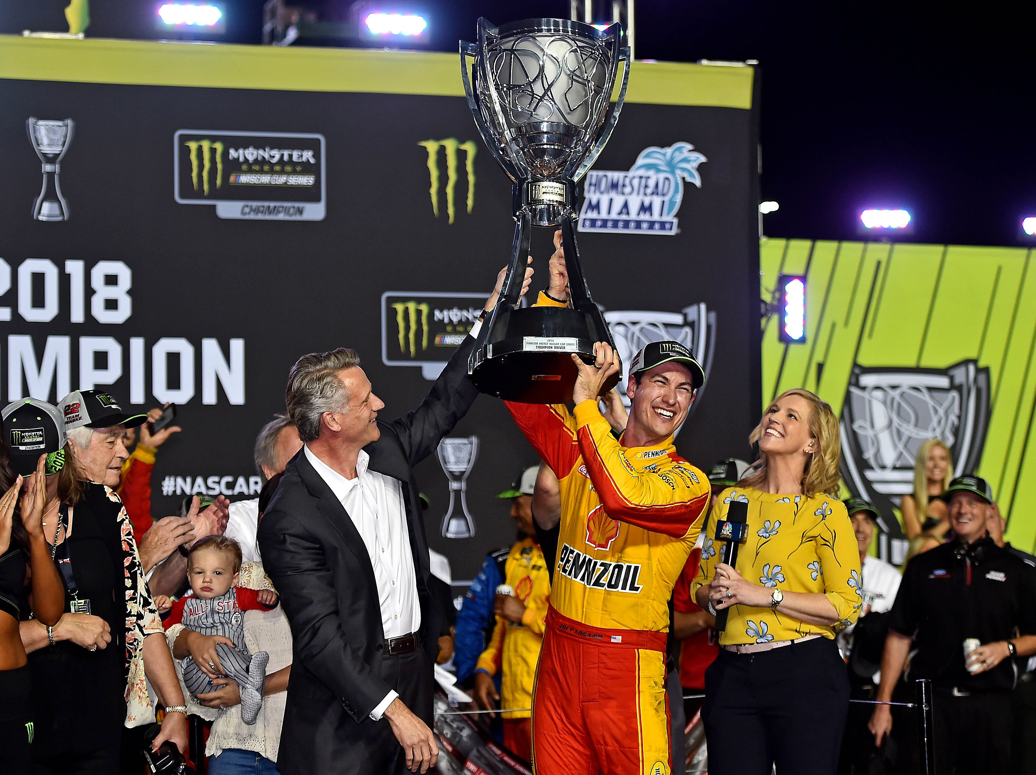Joey Logano (22) celebrates winning the NASCAR Cup Series championship at Homestead-Miami Speedway.