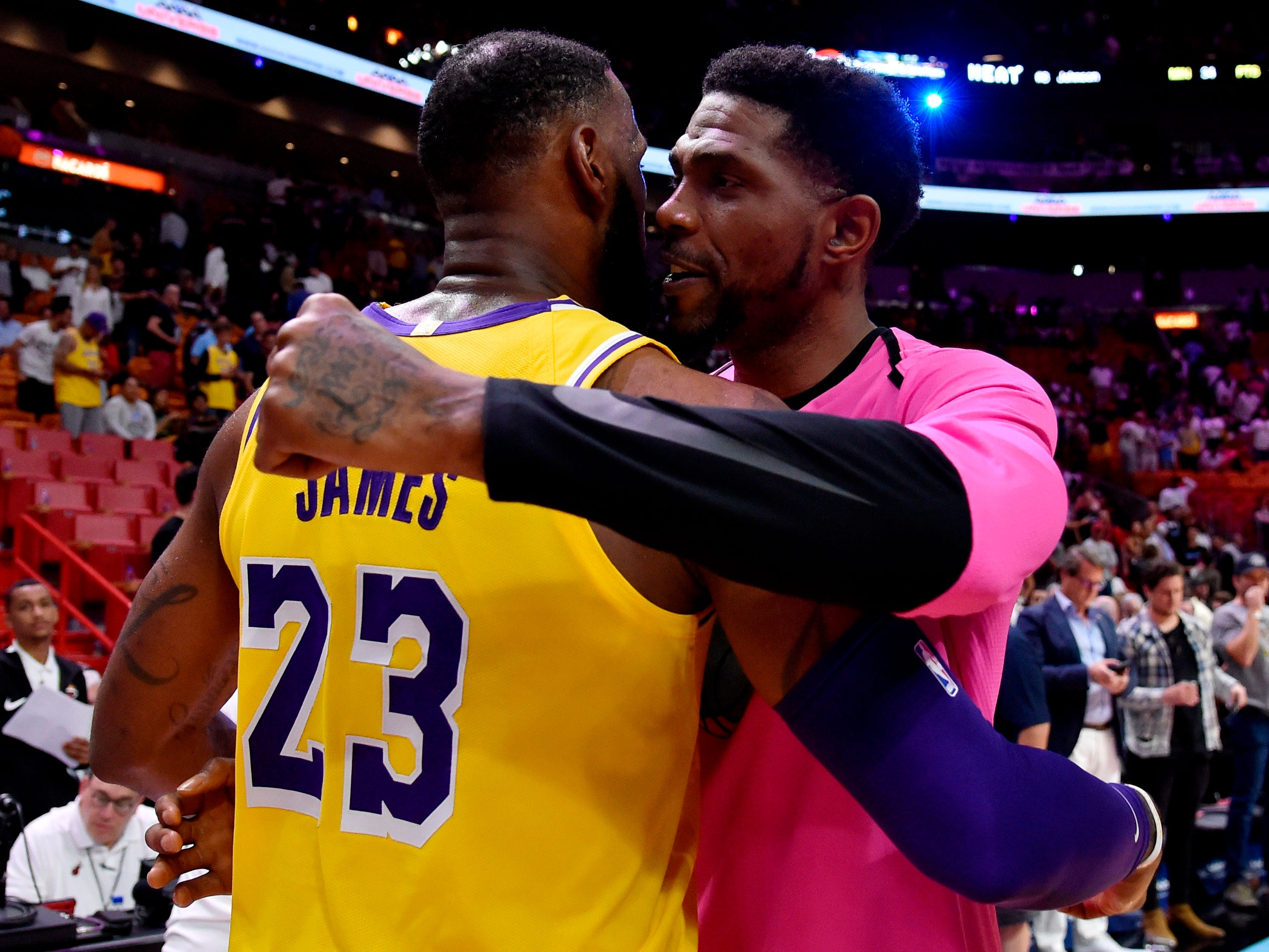 Nov. 18: James gets a hug from former teammate Udonis Haslem before the Lakers play the Heat in Miami. James and Haslem won two title together in 2012 and 2013.