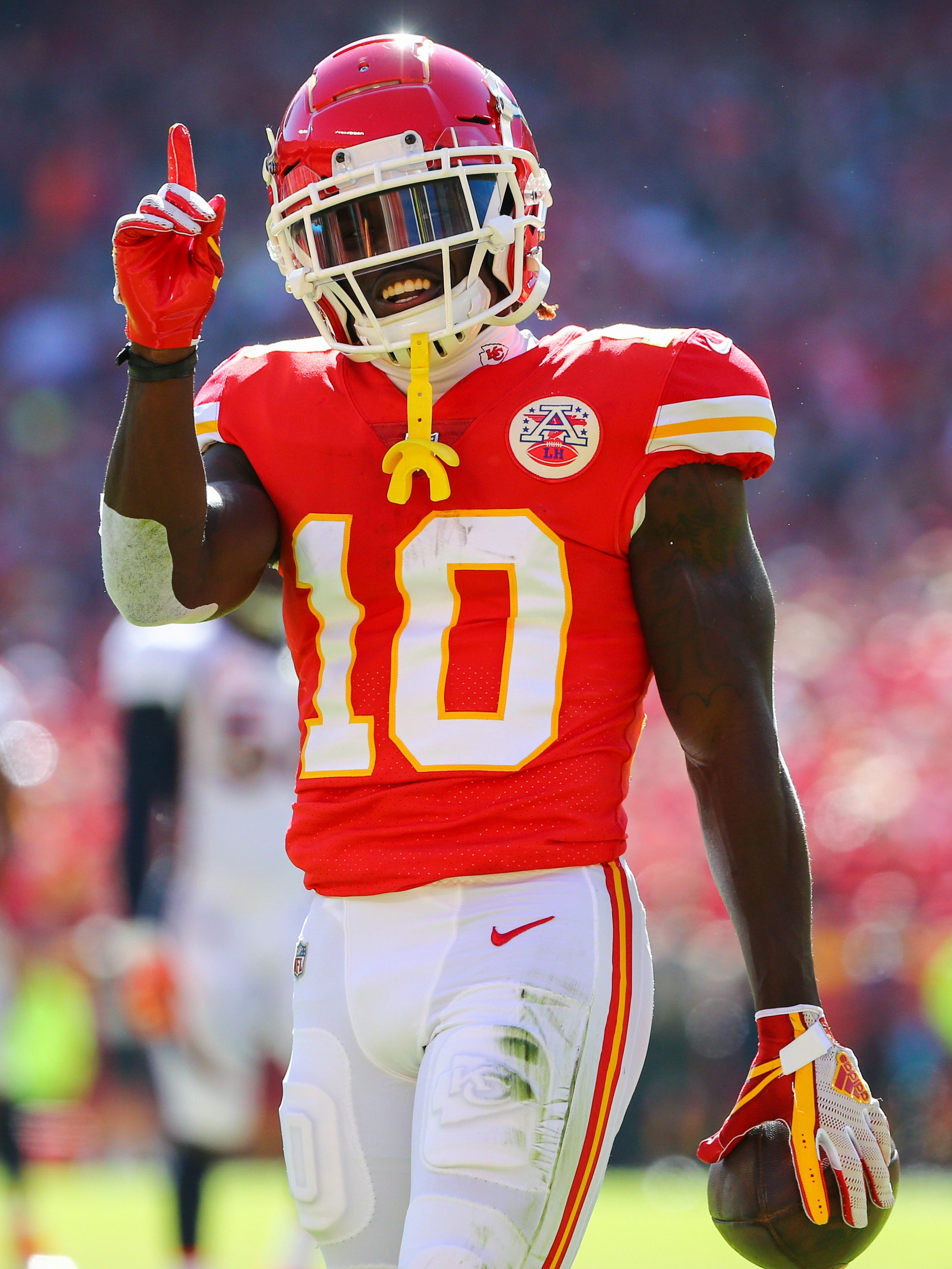 Kansas City Chiefs wide receiver Tyreek Hill (10) celebrates after a play against the Denver Broncos in the first half at Arrowhead Stadium.