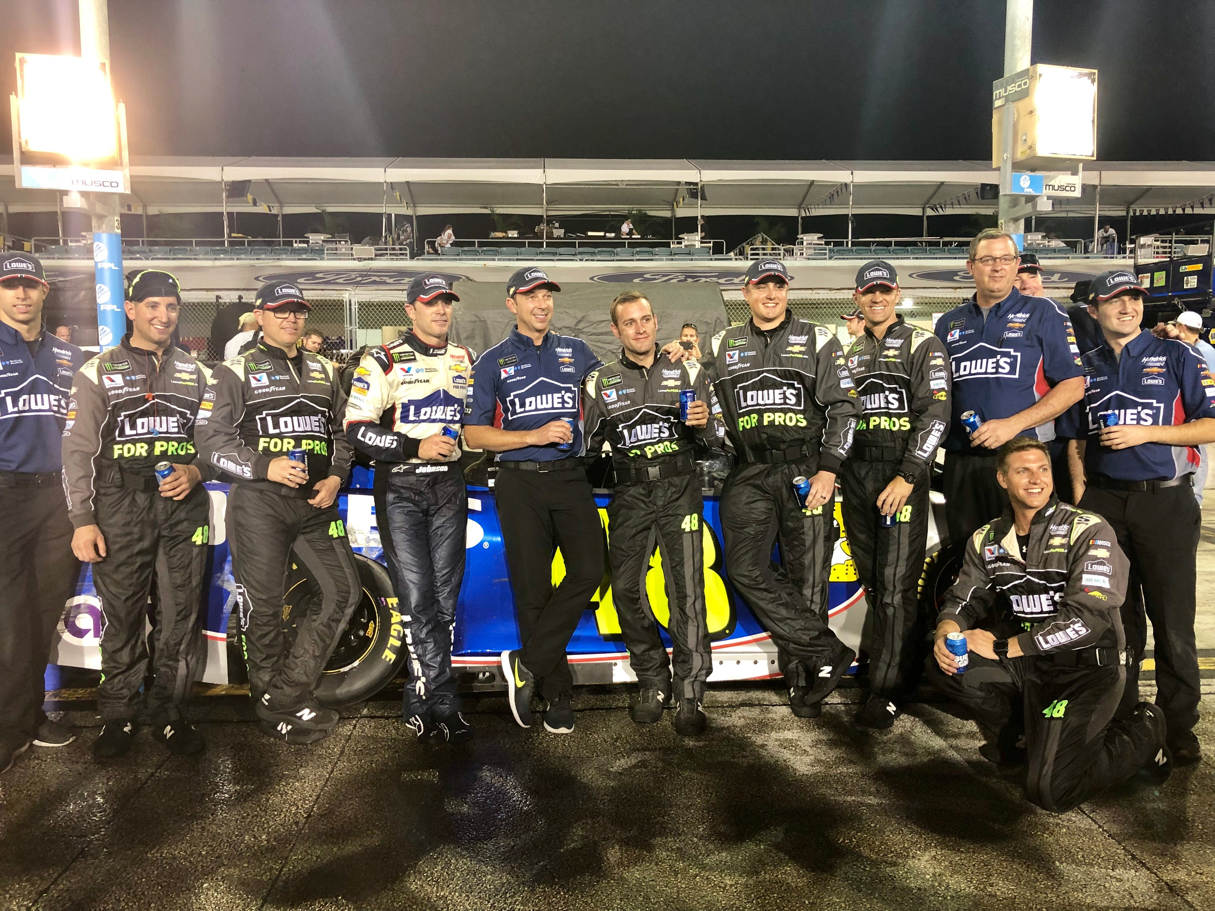 Jimmie Johnson, Chad Knaus and the No. 48 Hendrick Motorsports team gather for one last beer together on pit road.