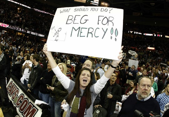 Fans held signs and led chants and jeers as LeBron James took the court and played his first game in Cleveland as a member of the Miami Heat.