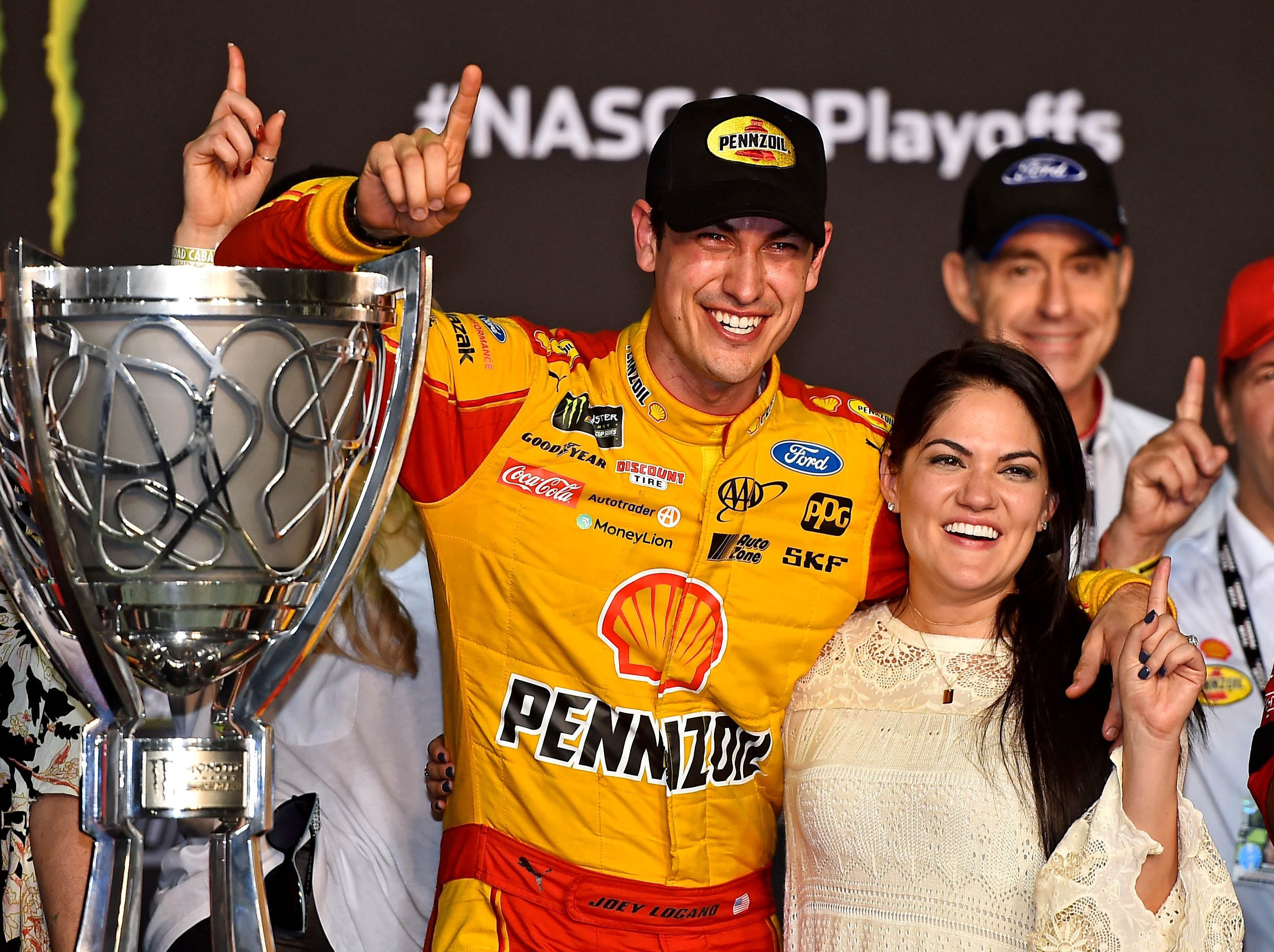 Joey Logano celebrates winning the NASCAR Cup Series championship with his wife Brittany at Homestead-Miami Speedway.