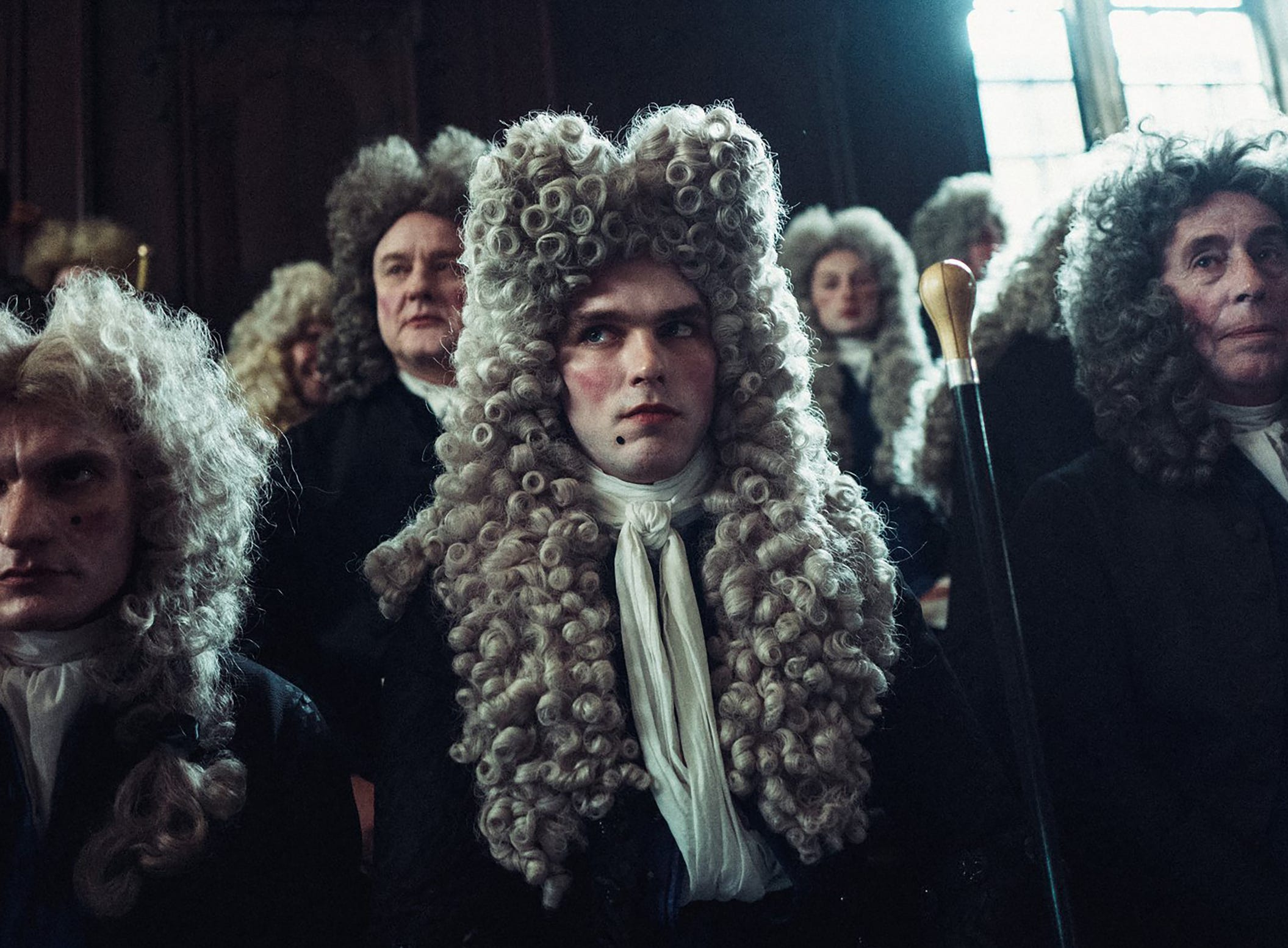 "Robert Harley (Nicholas Hoult, center) is a Tory leader who wants to use his royal connections for political gain in ""The Favourite."""