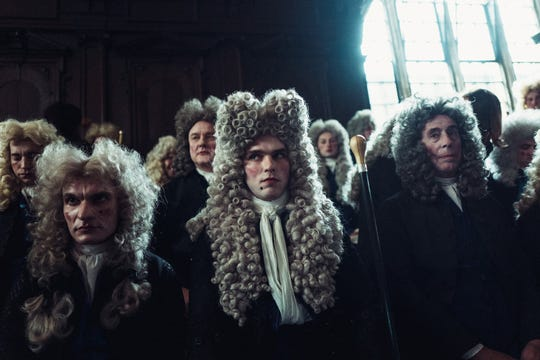 """Robert Harley (Nicholas Hoult, center) is a Tory leader who wants to use his royal connections for political gain in """"The Favourite."""""""