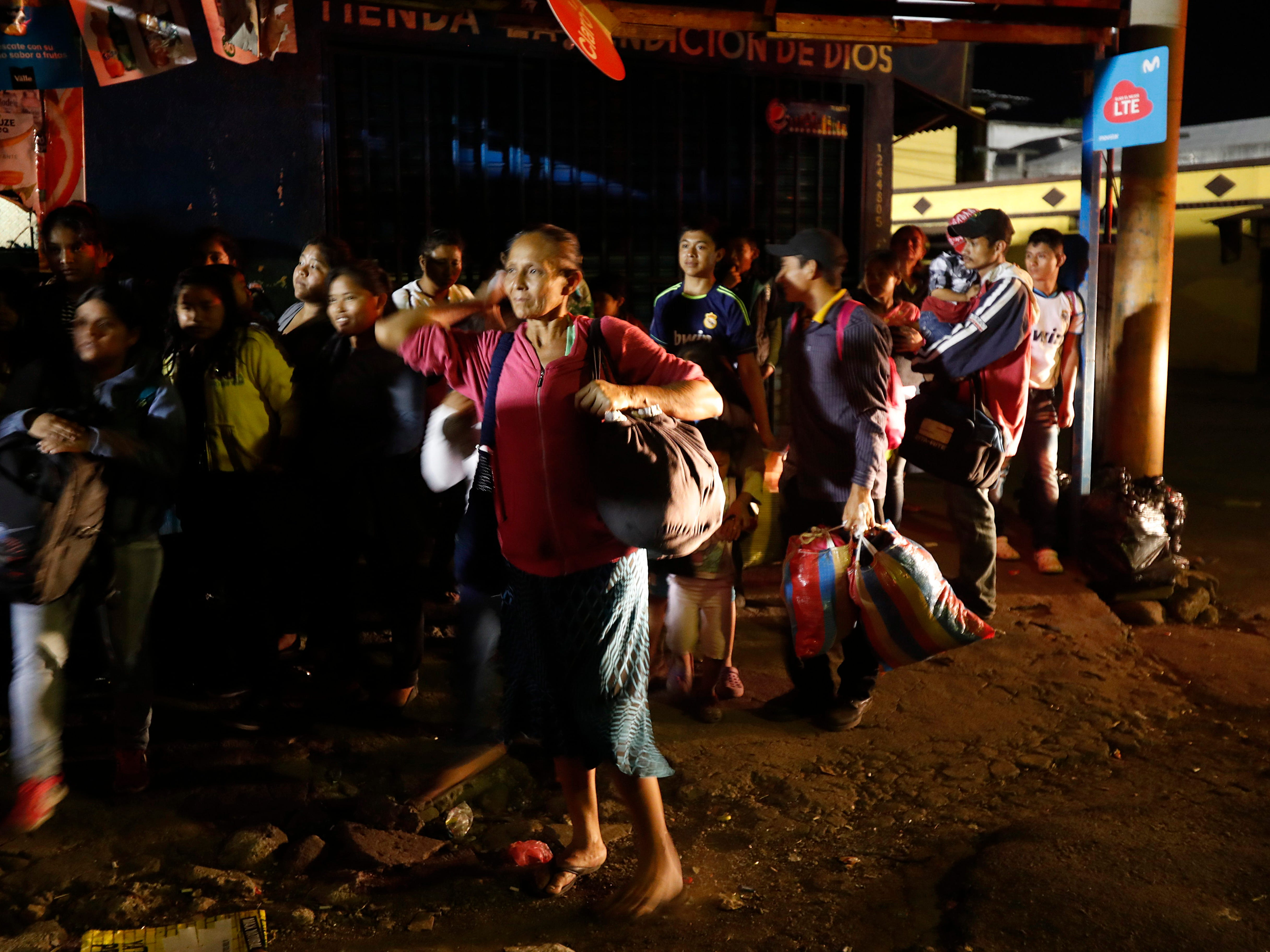 Evacuees from the Volcano of Fire area arrive at an emergency shelter in Escuintla, Guatemala, early Monday, Nov. 19, 2018.