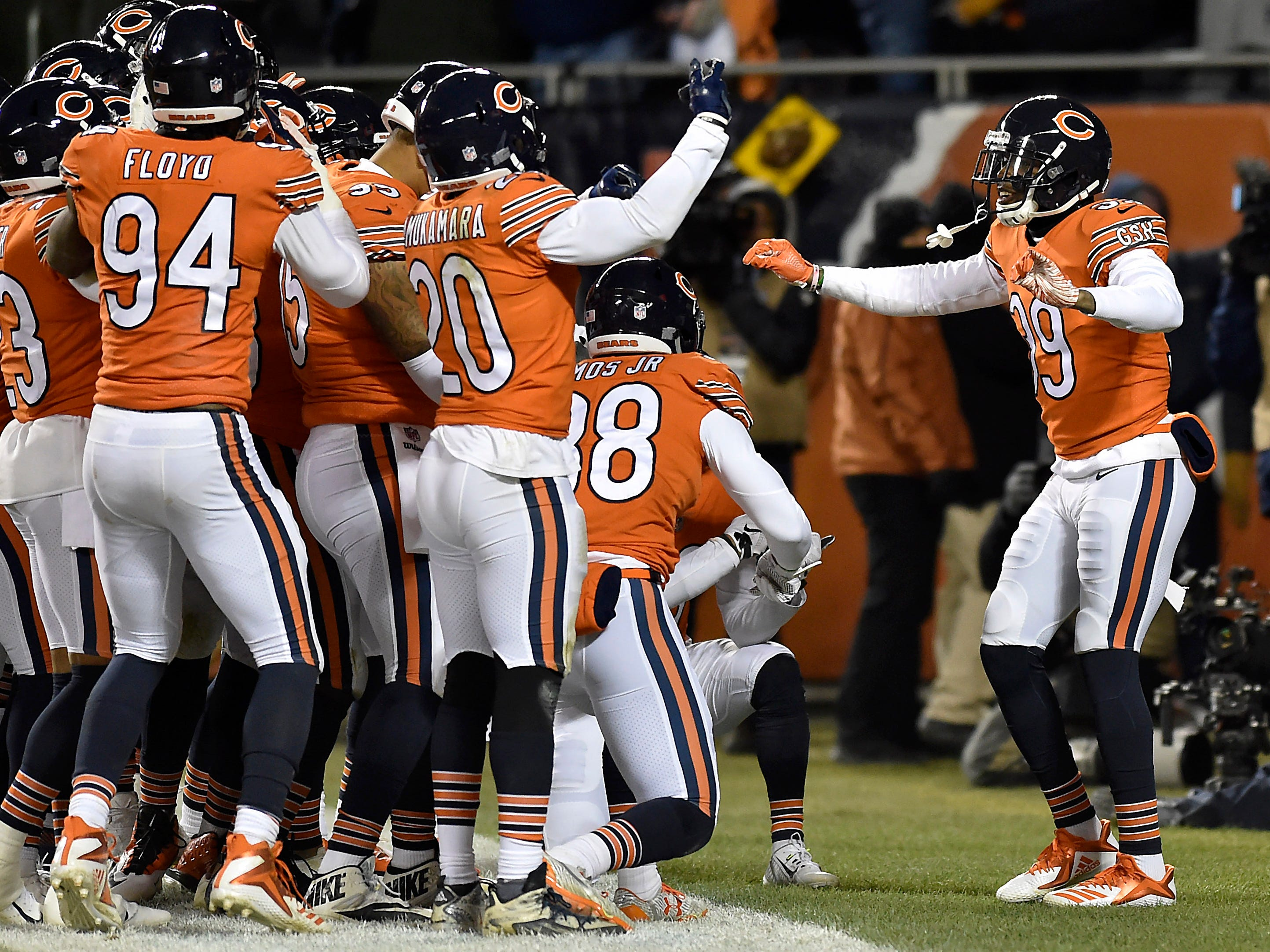 Chicago Bears free safety Eddie Jackson (39) celebrates in the end zone with teammates after scoring against the Minnesota Vikings at Soldier Field.