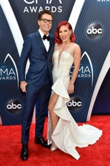 Bobby Bones (L) and pro partner dancer Sharna Burgess attend the 52nd annual CMA Awards.