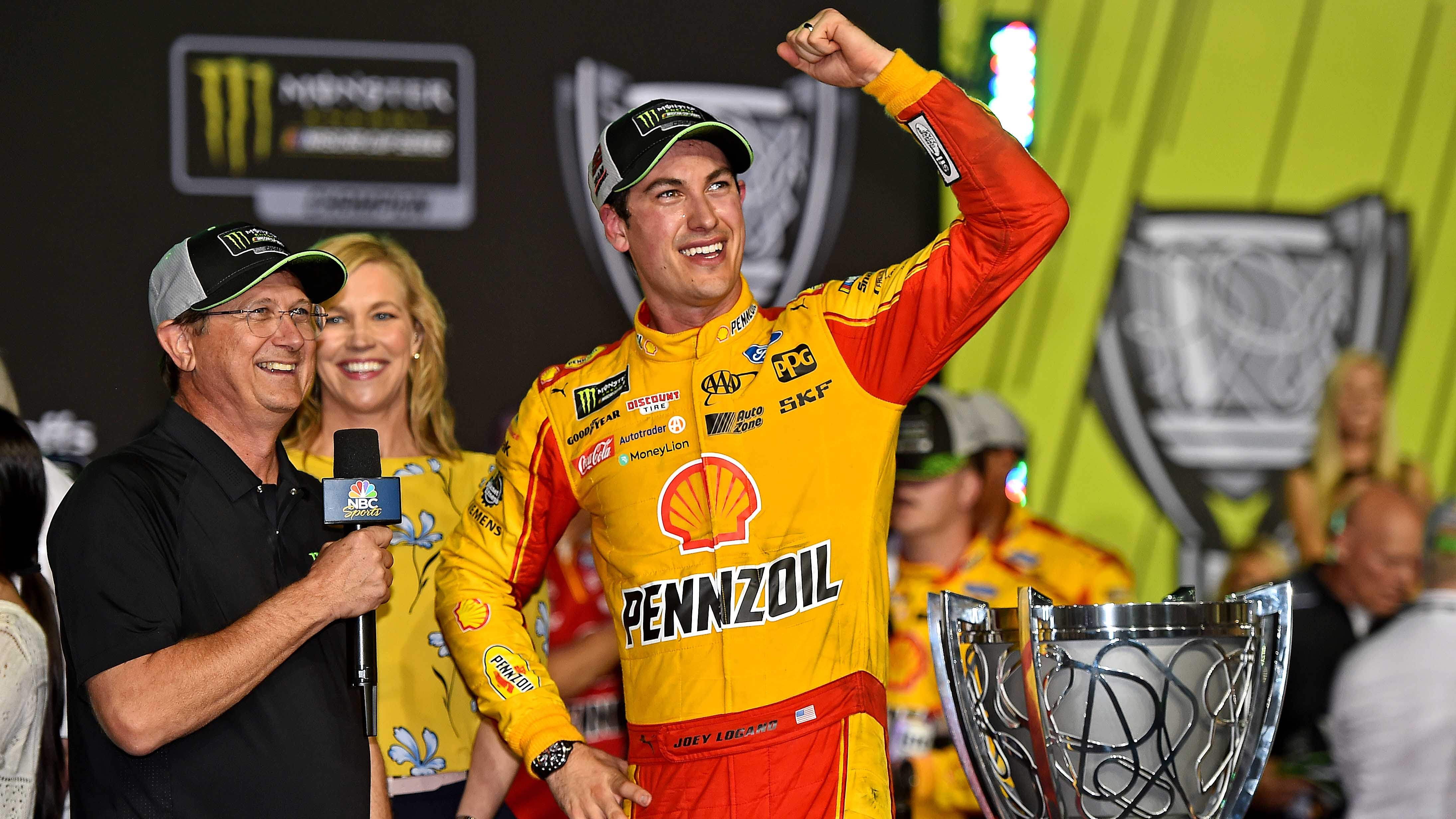 Joey Logano celebrates winning the Ford EcoBoost 400 and his first NASCAR Cup Series Championship, Sunday at Homestead-Miami Speedway.