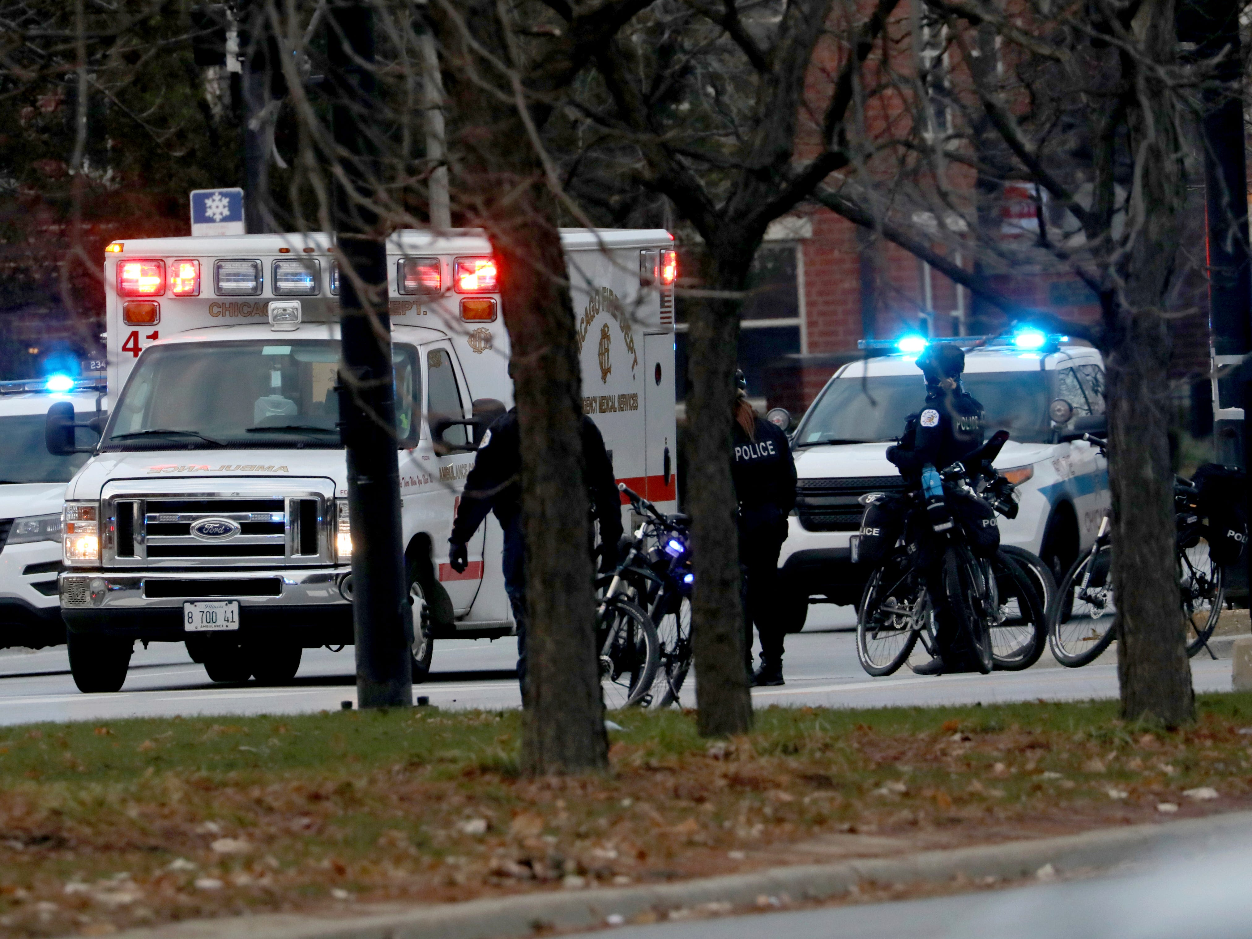 An ambulance believed to be carrying an injured Chicago police officer departs Mercy Hospital in Chicago on Nov. 19, 2018.