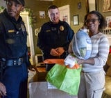 Anderson officers deliver Thanksgiving food