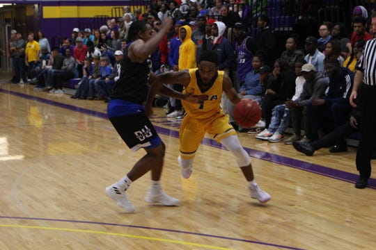 LSUA's Brandon Ellis (1) looks for a path to the basket against Dillard on Monday.