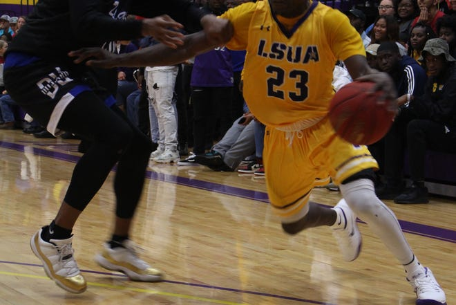 LSUA's JaMichael Brown(23) drives for two points against Dillard on Monday.