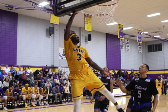LSUA's Malek Harris (3) attempts to dunk Monday against Dillard.