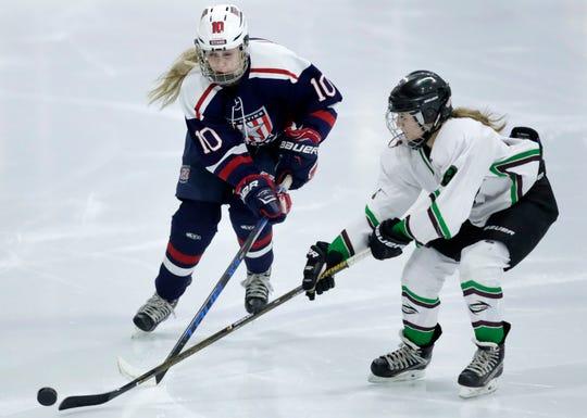 Fox Cities Stars' Madelynn Jablonski, left, skates against Ellen Padgett of Northern Edge during a game last season.