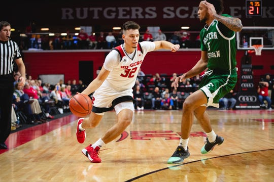 Rutgers' Peter Kiss drives against Eastern Michigan
